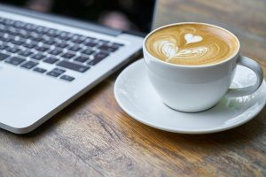 coffee by a laptop